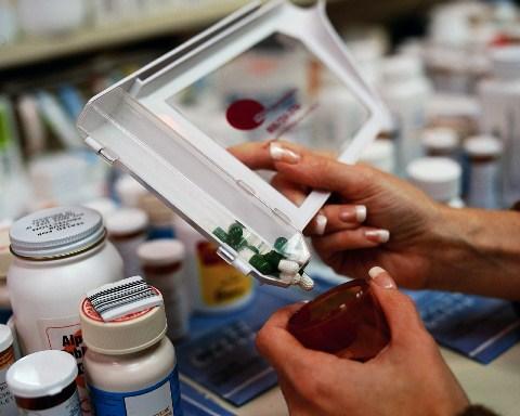 Pharmacy, filling pill bottles