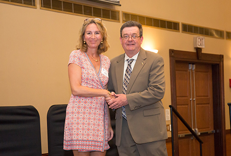 Dr. Winterstein shakes hands with Norton at Luncheon honoring Winterstein as UF Research Foundation Professor