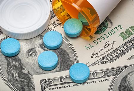 Pills spilled on hundred dollar bills