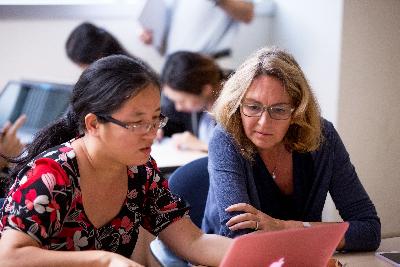 POP graduate faculty reviewing data.