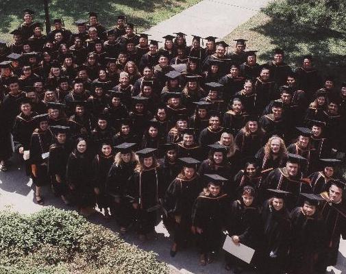 graduates standing on lawn